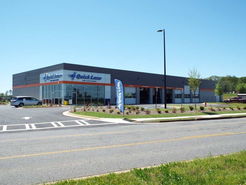 Quick Lane Steel Retail Building With Multiple Roll Up Door Bays And Attractive Building Finish