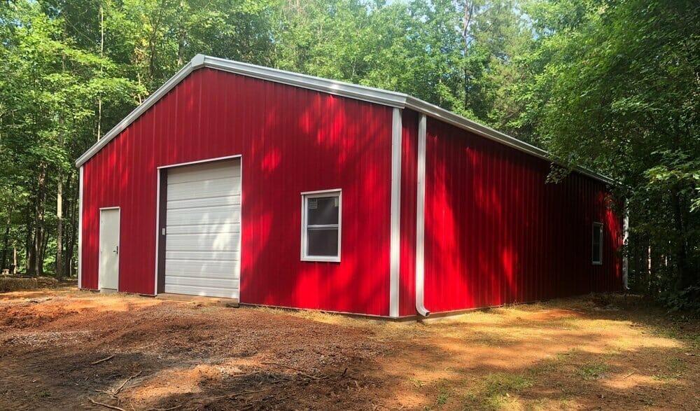 Custom Pre-Engineered Metal Garage Building With Roll Up Garage Doors And Side Entry Door