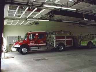 Fire Engine Parked Inside Pre-Engineered Metal Fire Station Buildings