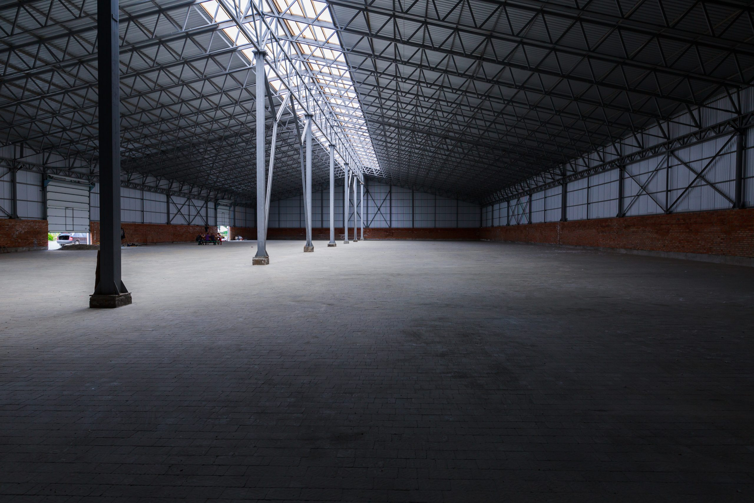 Large Pre-engineered Metal Building Interior With Lighting And Steel Beams