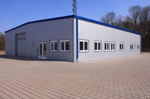 Large Pre-engineered Metal Building With Custom Roll Up Doors, Side Entry Doors, Windows, Gutters, And Trim