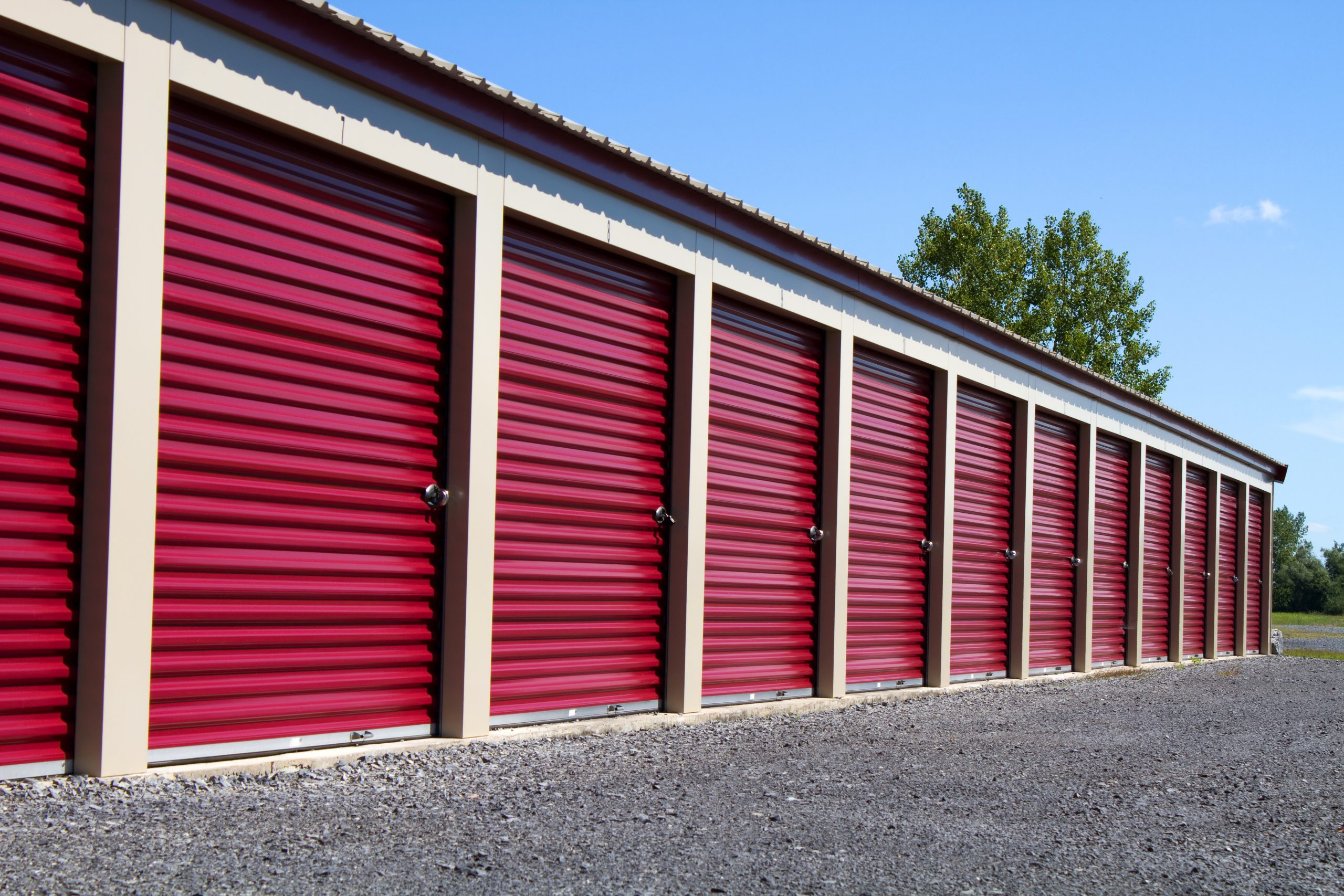 Row Of Metal Mini Self Storage Rental Units With Roll Up Doors