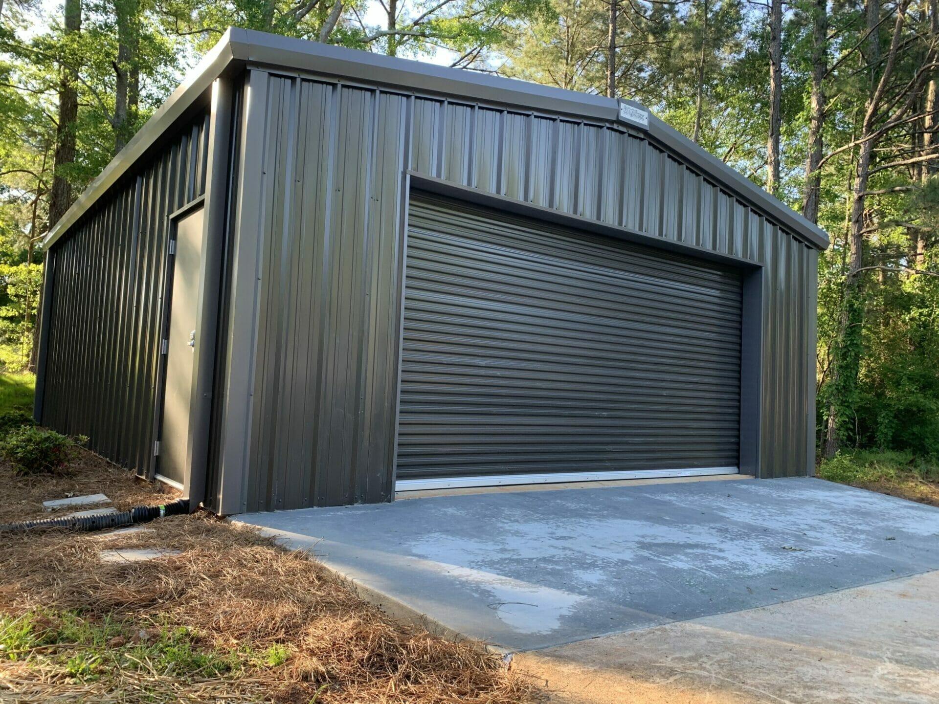Pre-Engineered Metal Garage Building With Roll Up Garage Door And Side Entry Door