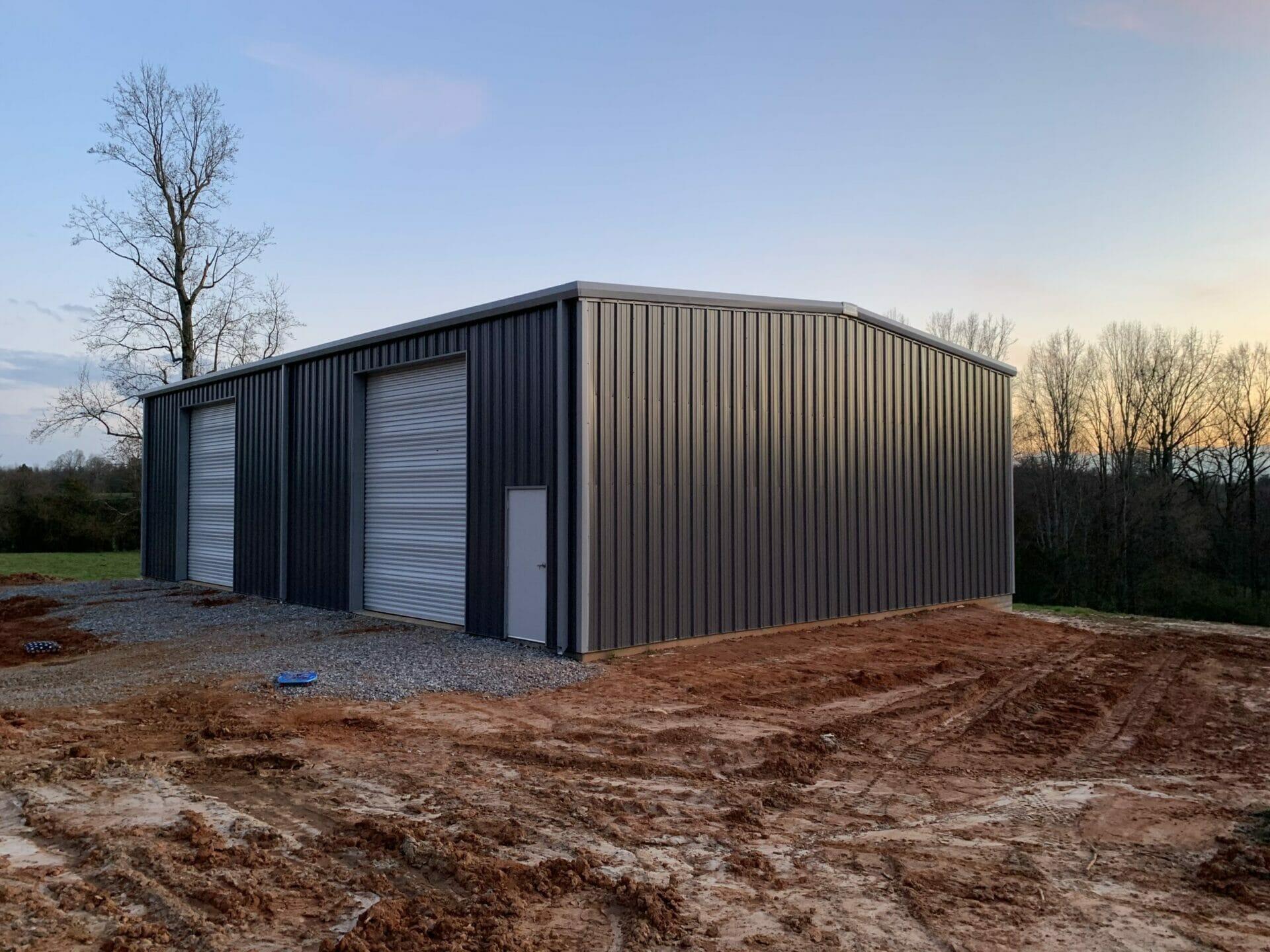 Pre-Engineered Metal Multi-Bay Garage Building With Roll Up Garage Doors And Standard Door