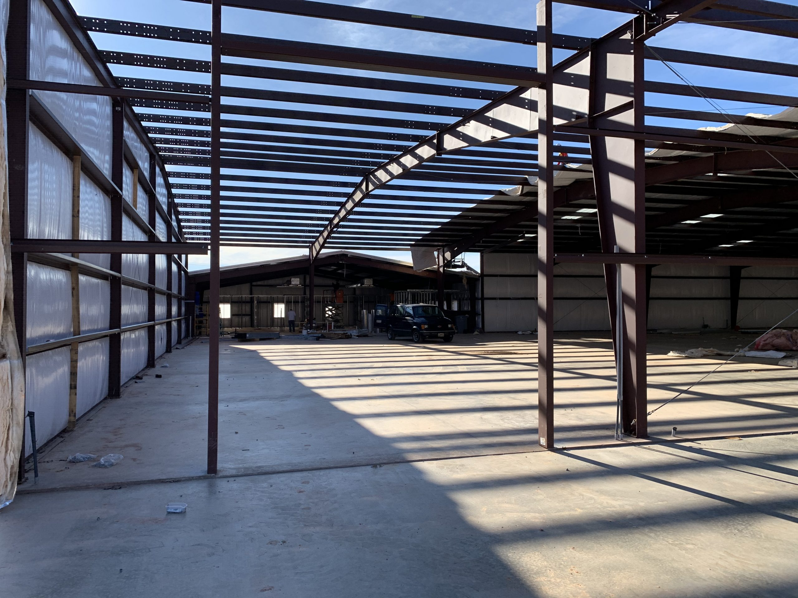 Steel Frame Building Progress Photo In Industrial Setting