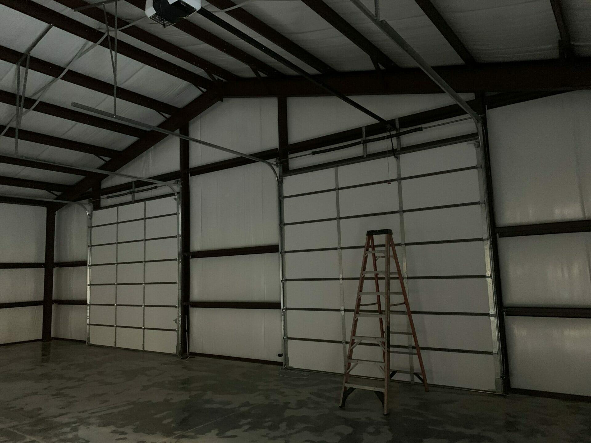 Interior View Of Pre-Engineered Metal 2 Car Garage Building With Roll Up Garage Doors