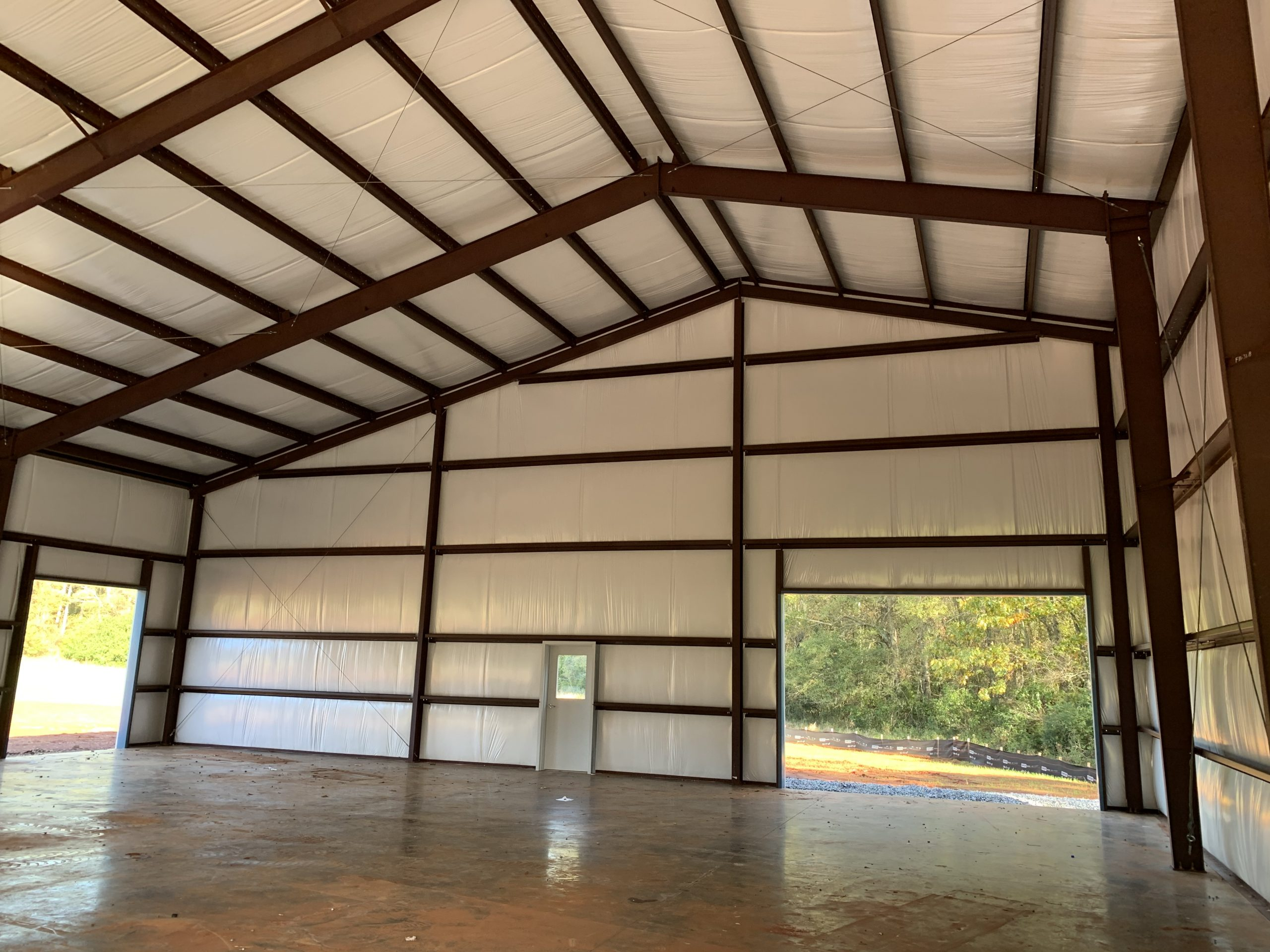 Pre-Engineered Metal Workshop Building With High Clearance Side Entry Doors And Roll Up Garage Doors