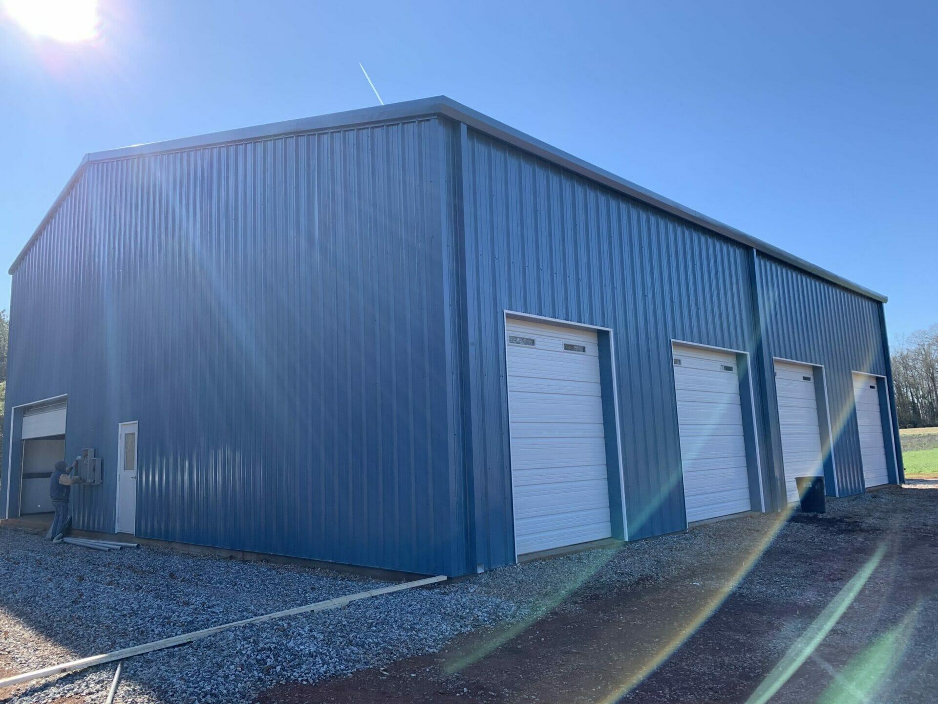 Custom Pre-Engineered Metal Garage Building 5 Bays With Roll Up Garage Doors And Side Entry Door