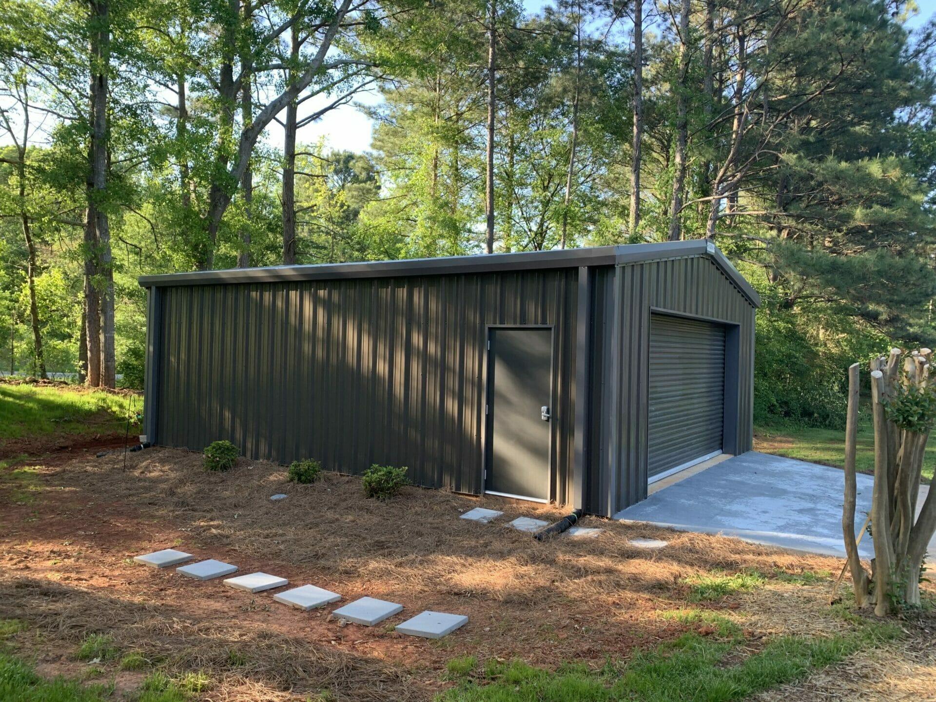Pre-Engineered Metal Garage Building With Roll Up Garage Door And Side Entry Doors
