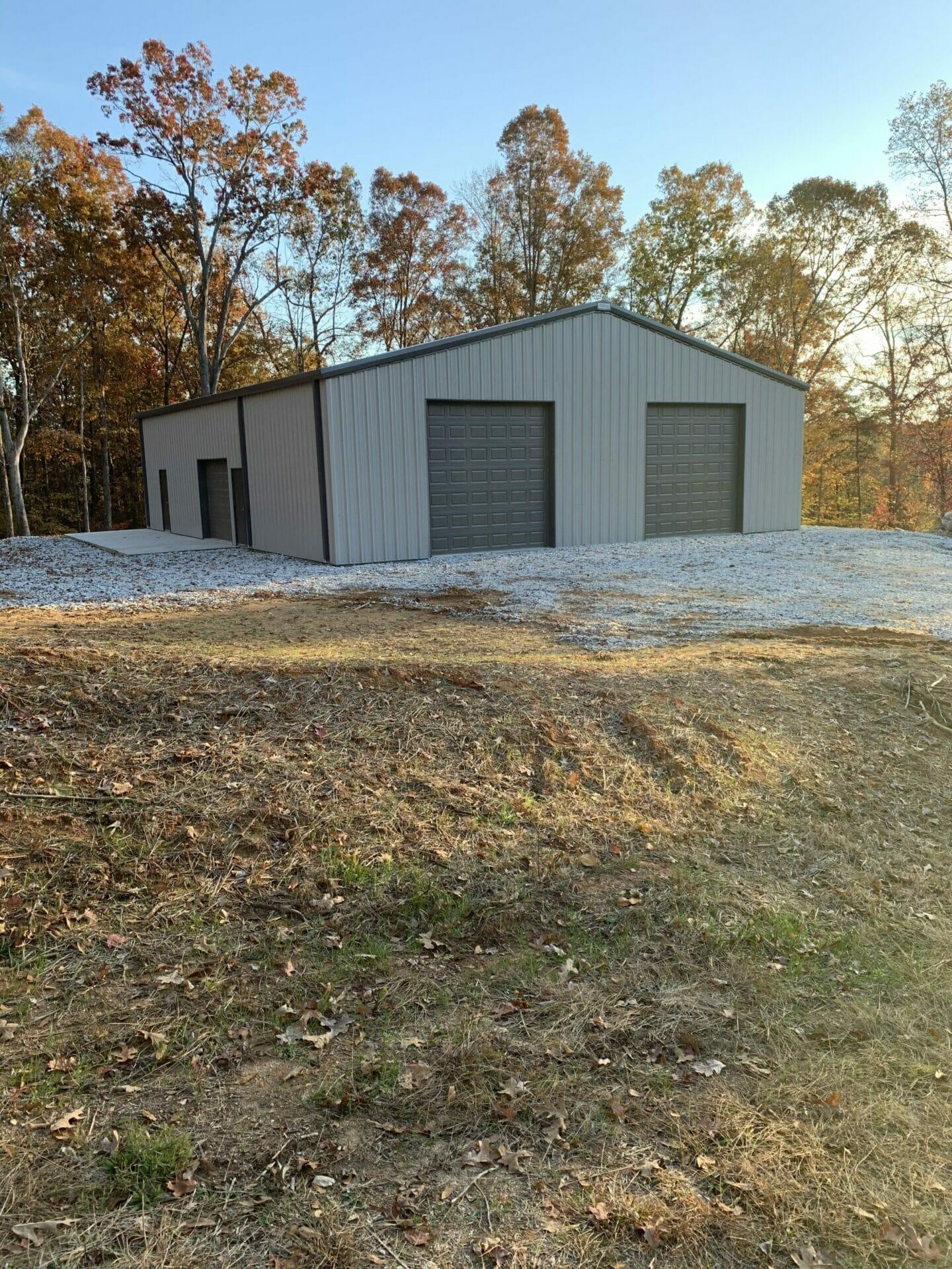 Pre-Engineered Metal Garage Building With Roll Up Garage Door, Custom Windows, And Standard Doors