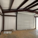 Pre-Engineered Metal Garage Building With Standard Entry Doors And Roll Up Garage Doors
