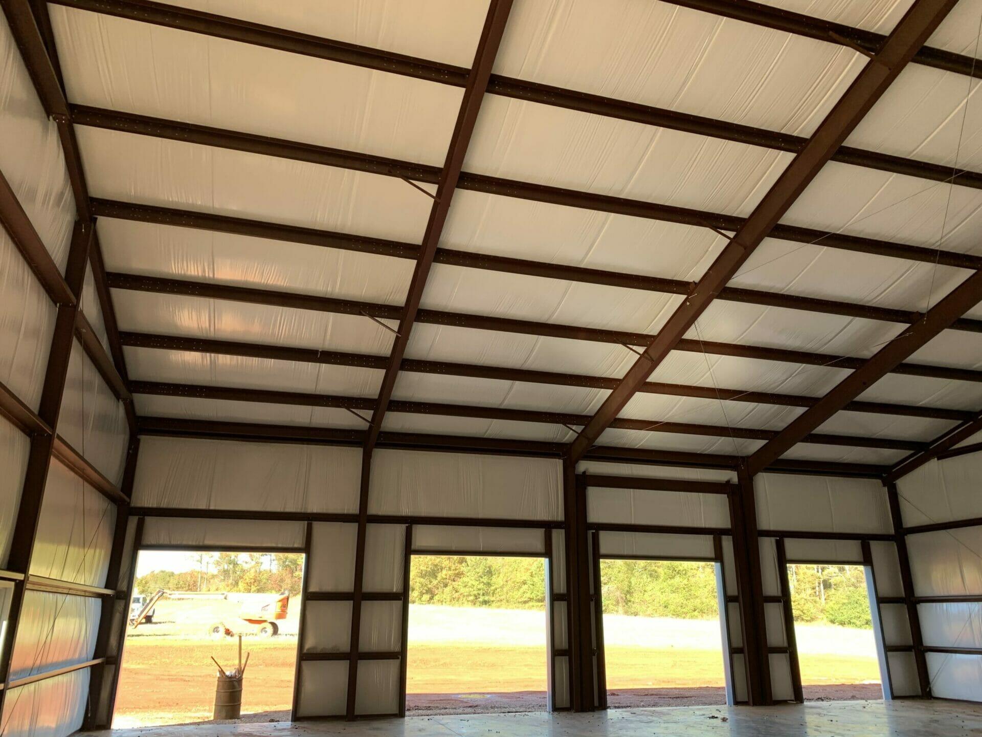 Interior View Of Pre-Engineered Metal Garage Building With Roll Up Garage Doors