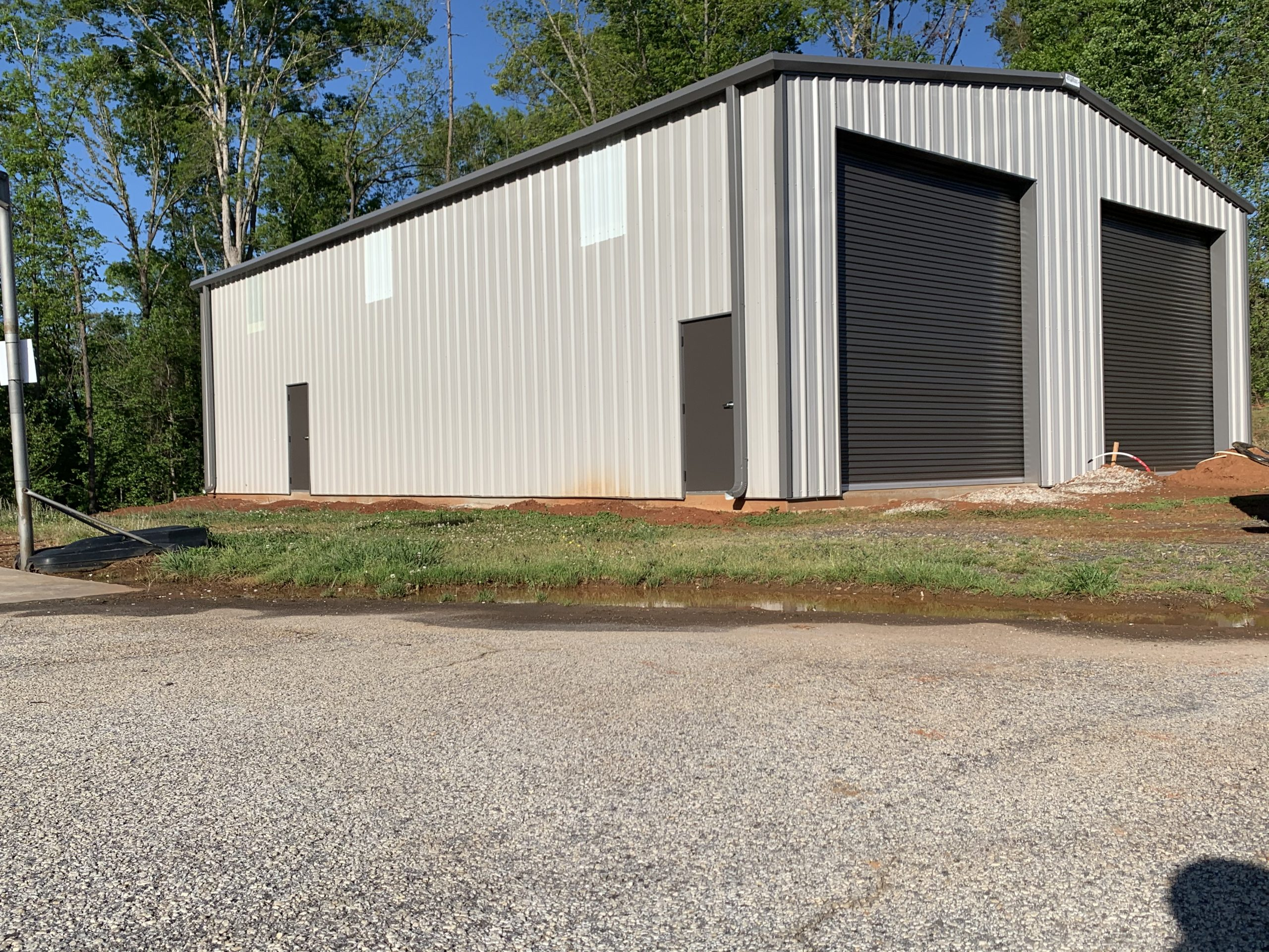 Pre-Engineered Metal Garage Building With Side Entry Doors And Roll Up Garage Doors
