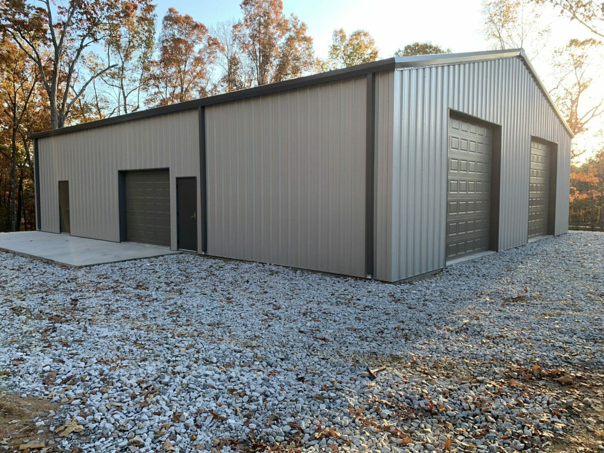 Pre-Engineered Metal Garage Building With Roll Up Garage Door, And Standard Doors
