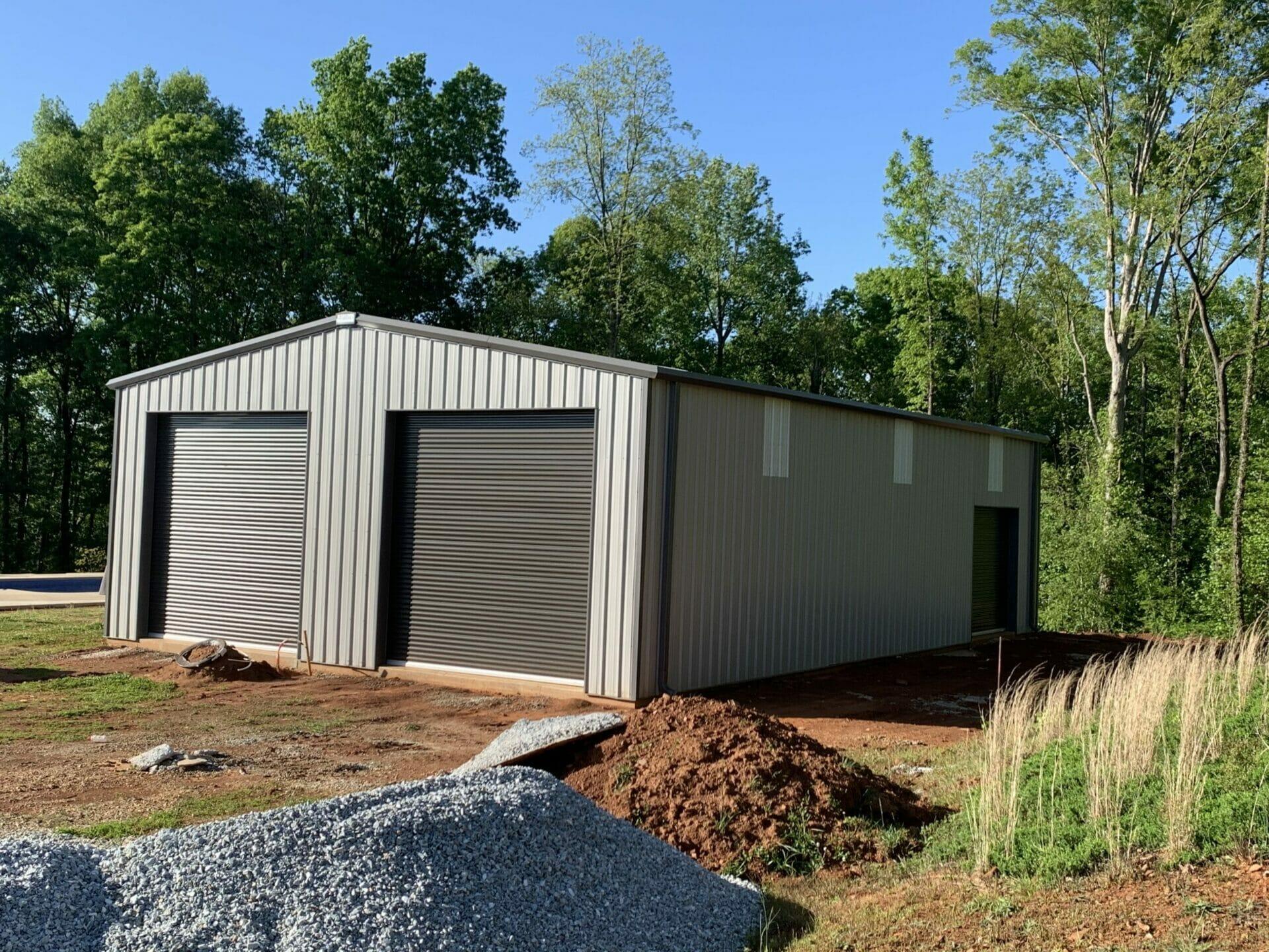 Custom Pre-Engineered Metal Multi-Bay Garage Building With Roll Up Garage Doors And Side Entry Door