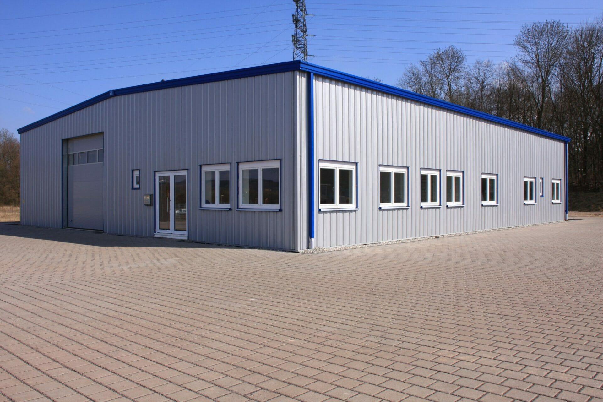 Pre-Engineered Metal Garage Building With Roll Up Garage Door And Standard Door