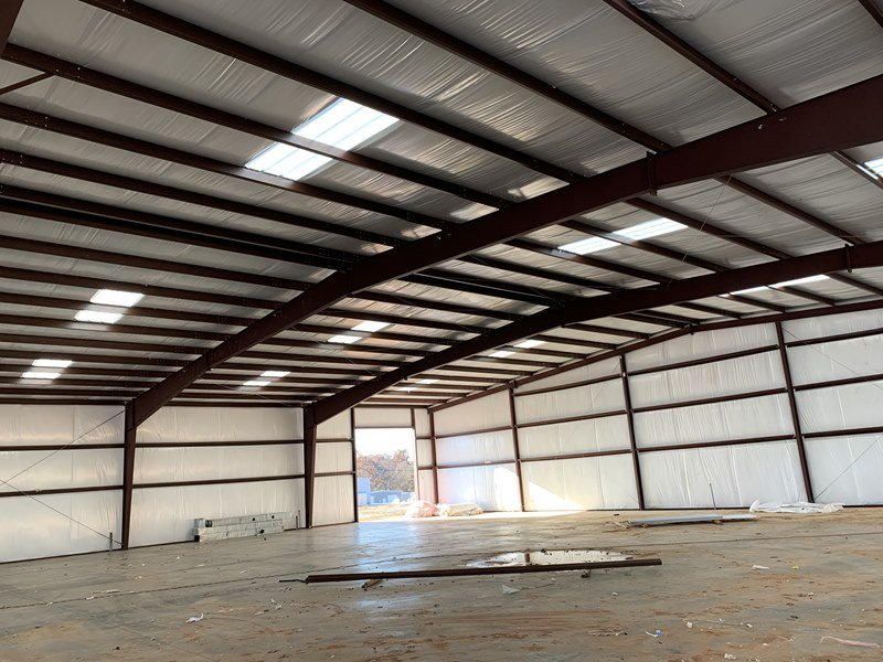 Interior View Of Custom Pre-Engineered Metal Multi-Bay Garage Building With High Clearance Steel Beams